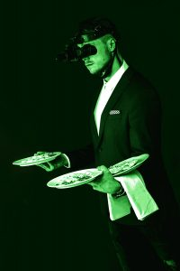 Weitor carrying food with night vision googles